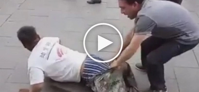 Chinese man forcefully pulls of 'disabled' beggar's pants to expose how he deceives passersby