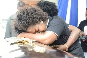 Emotions and pure 'mudness' as gospel singer Gloria Muliro's dad is buried (photos)