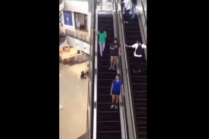 Epic Fail! Shocked mall-goer unconsciously steps on the wrong escalator
