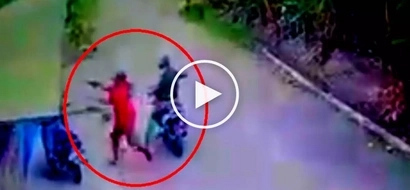 Scary riding-in-tandem hold-uppers in Cebu rob defenseless lending collector