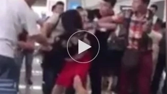 WATCH: Wife beats husband's mistress when she catches them at the airport