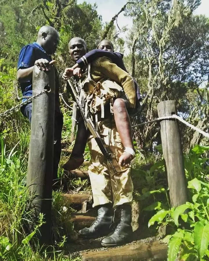 Kenya Wildlife Service ranger warms Kenyans hearts by carrying disabled pupil to view Chania Falls