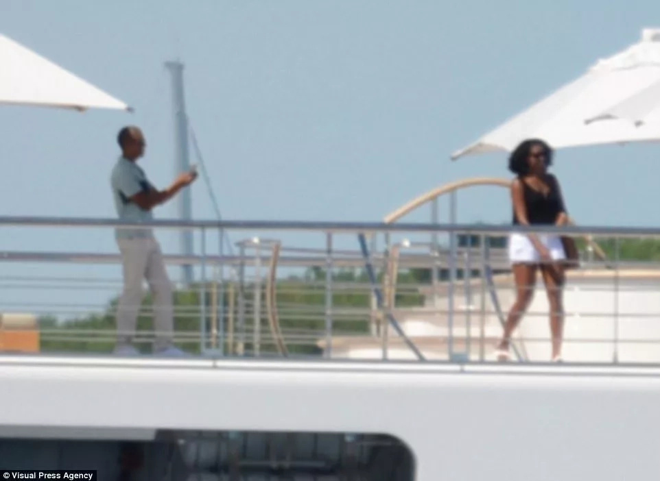 Barack and Michelle Obama seen on holiday with celebrities on N90b super yacht