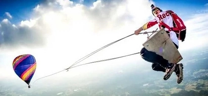 Crazy adrenaline junkies swing on a 125meter swing from a hot air balloon