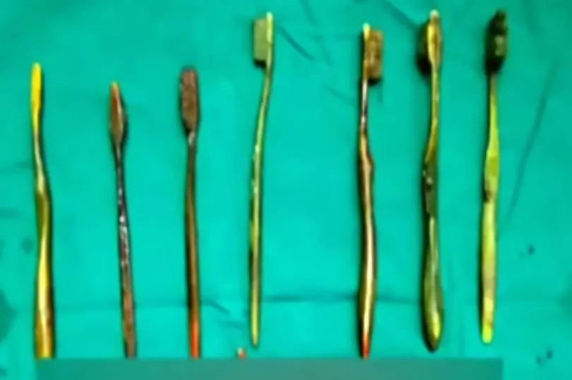 You will be surprised why distraught woman swallows 7 toothbrushes (photo)