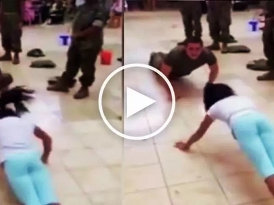 Slim girl embarrasses tough soldier by defeating him in epic push-up competition