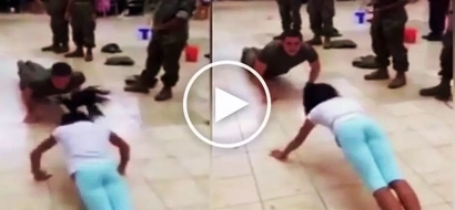 Young teen girl embarrasses tough soldier by defeating him in epic push-up competition