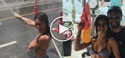 Coleen Garcia and Billy Crawford splash buckets of water at strangers in Thailand