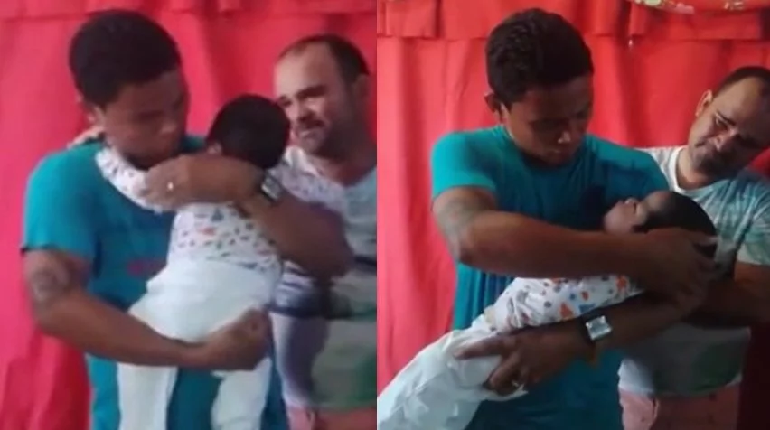 This father takes out his son from coffin and doesn't want to put him back
