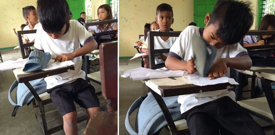 Student uses slipper as eraser