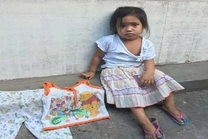 Lost child cries as she roams the streets of Quezon City in her quest for home