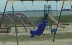 WATCH: Dad films creepy video of a ghost playing on the swing