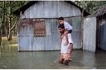 Man's son was sad because he couldn't go to school due to floods, so he carried him there