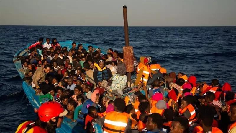 Migrants Storm Beach in Southern Spain as Confused Sunbathers Look On