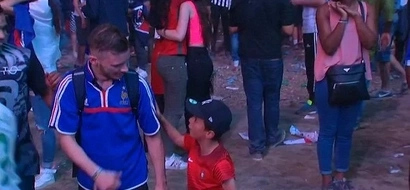 Frenchman is devastated over his team's loss; what this Portuguese kid does will touch your heart!