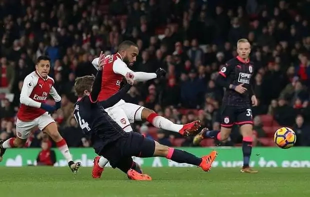 Arsenal fire from all cylinders to score five past sorry Huddersfield