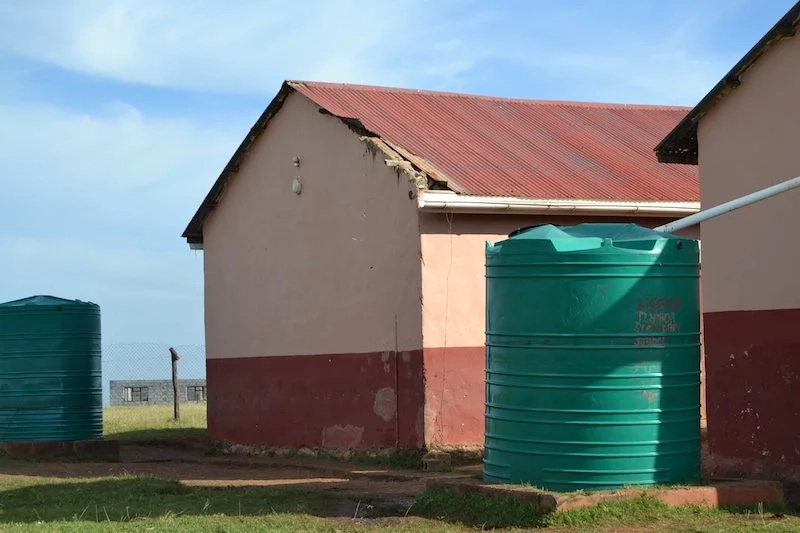 The school does not have tap water and relies on rain water collected in these two tanks