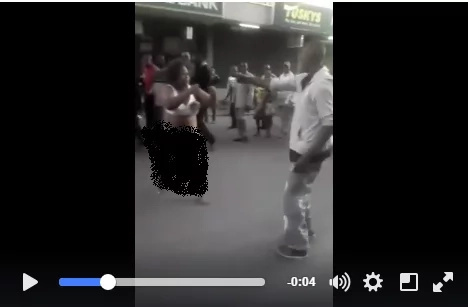 A couple fighting in Nairobi causes a spectacle as woman strips