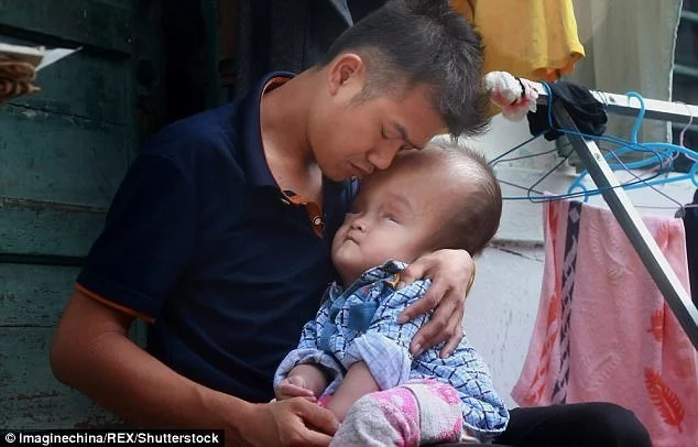 Jiang has vowed to take care of his twins. Photo: Imaginechina/REX/Shutterstock