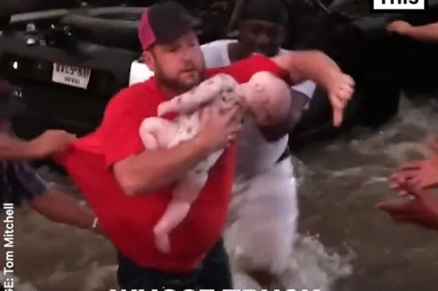 Rescuers help man rescue children from car