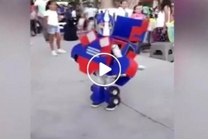 This is cuteness overload! Child wears a transformers' costume...what happened to him was unexpected!