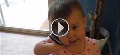 The most charming telephone talk in the world. Emilia talks to the important man in her life