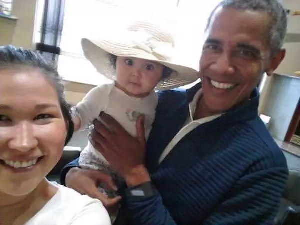 Obama holding a wide-eyed Giselle as her mother takes the picture. Photo: Jolene Jackinsky