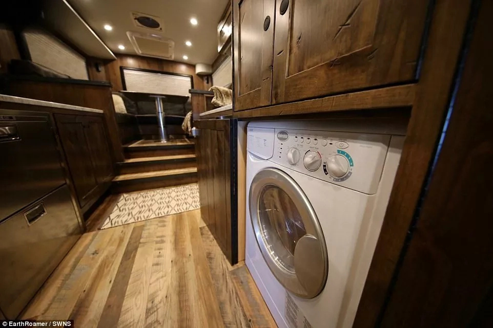 It comes with a washing machine, fridge freezer, heated floors, oven and microwave. Photo: SWNS