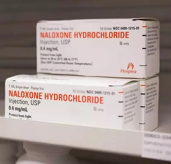 Should Naloxone be present in the first aid box?